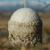 Lace Christmas Ball made by Mary Mauz using hand-knit beaded lace edging and handmade wool felt ball
