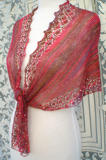 Shallow Tri Shawl worn in traditional triangle shawl style with front tails tied