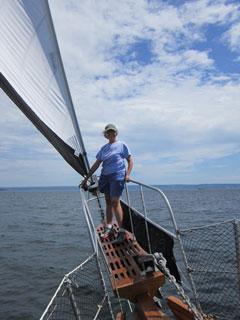 Jackie on the bow of the Amoeba sailboat