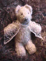hand knitted teddy bear and shawl in handspun Teeswater wool